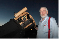 Andrew Planck with telescope viewing objects on the moon