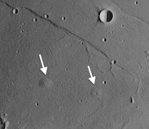 lunar domes, low rounded features that resulted from magma which rose from underneath and created blister-like hills on the Moon's surface